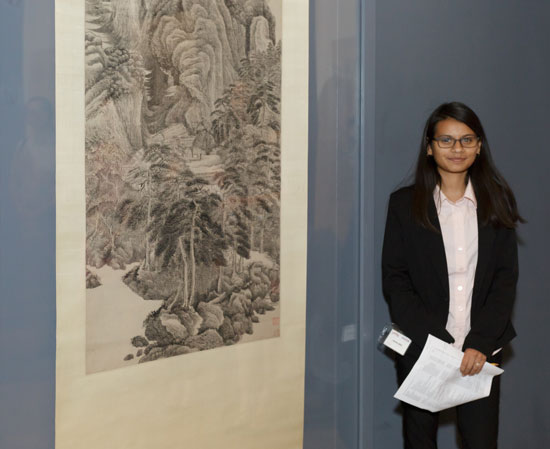 2015 Summer Academy student Kathya Lopez standing next to Reciting Poetry before the Yellowing of Autumn by Wu Li, Photo © Museum Associates/LACMA.