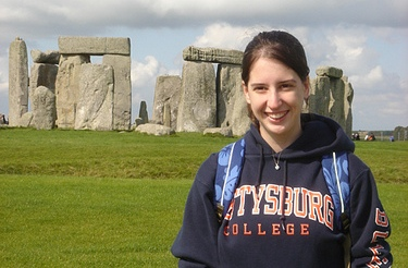 A history major student standing in front of Stonehenge