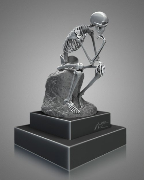 A skeleton sitting on a rock