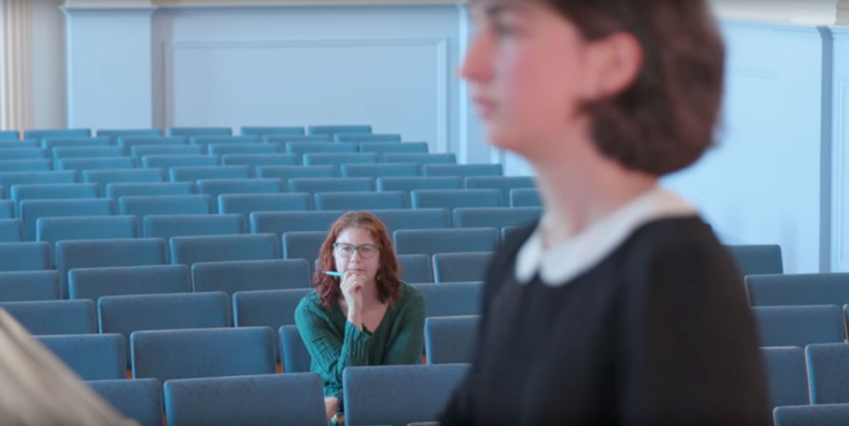 Two students in a music audition room
