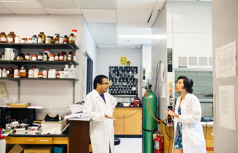 Student working with Professor on research in a science lab