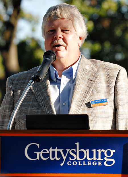 Bob Garthwait Jr. standing at a podium