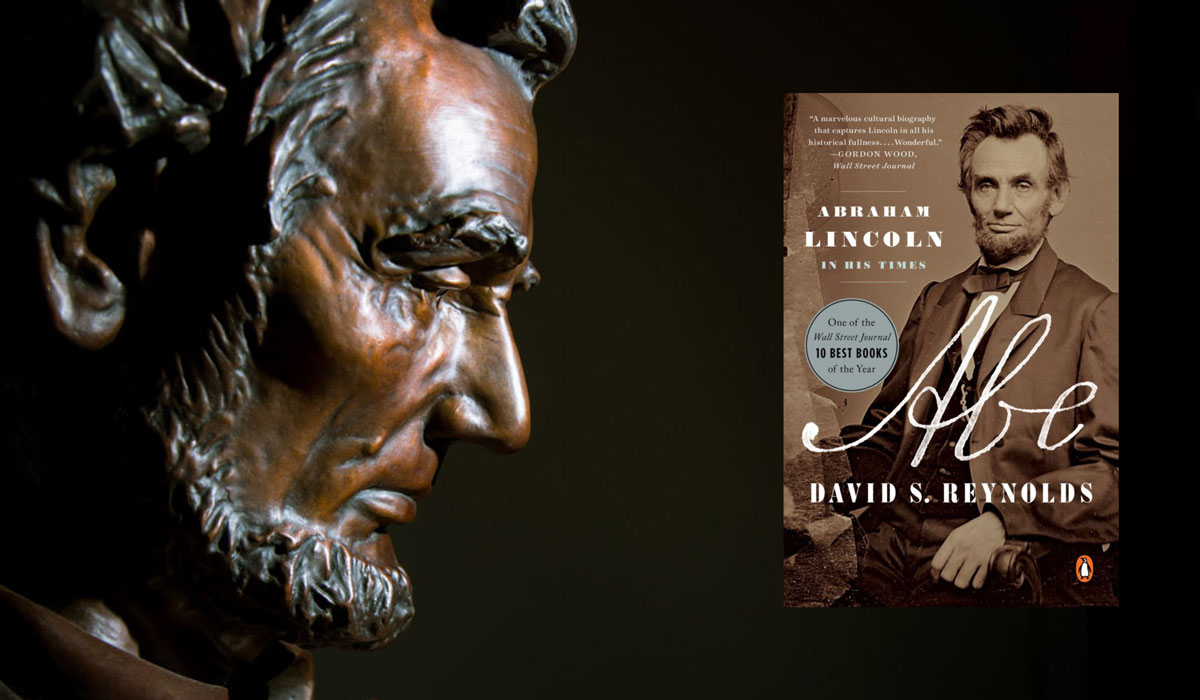 Bust of Abraham Lincoln with an image of the book jacket for Abe: Abraham Lincoln in His Times