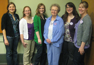 Barbara Holley stands with Holley Interns