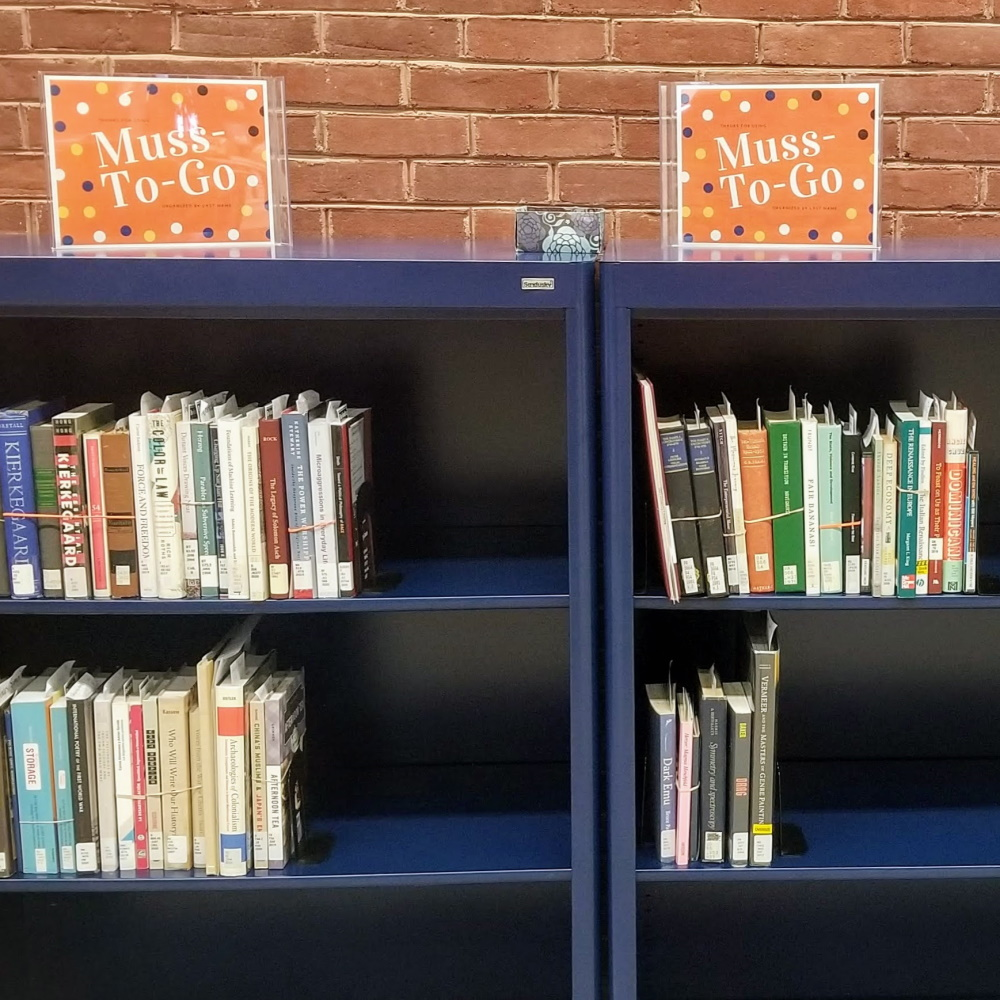 Muss-To-Go shelves filled with books for pickup