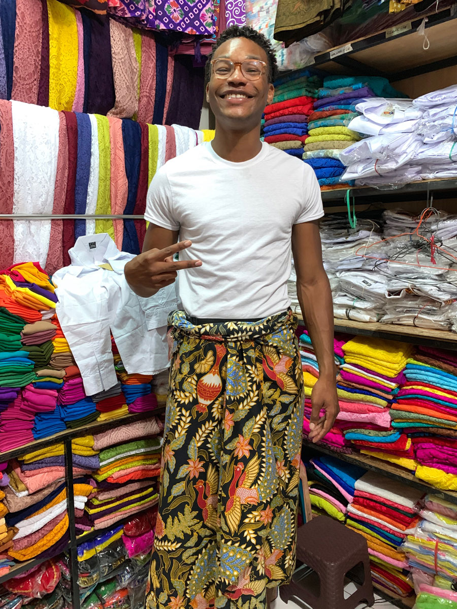 Churon T. Lanier-Martin in a clothing store in Bali wearing traditional Balinese clothes