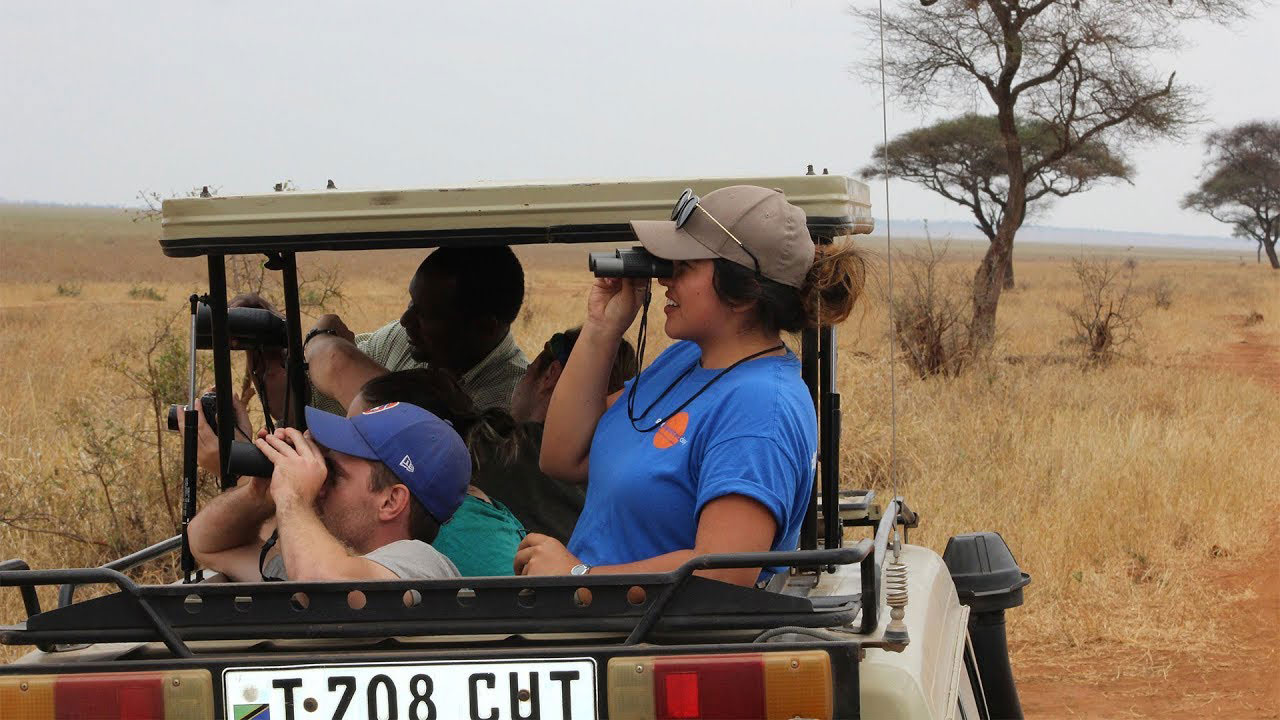 Venissa Ledesma 19 using a telescope on a jeep car in Tanzania