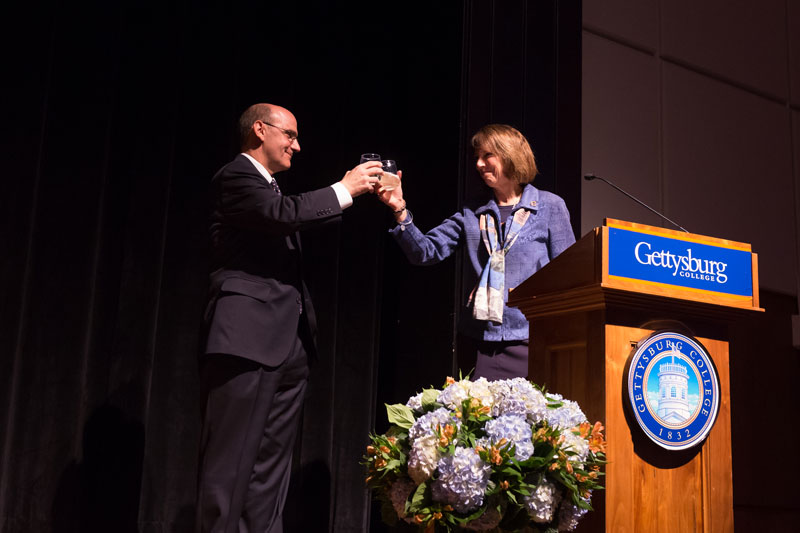 Pres. Iuliano and Pres. Riggs share a toast