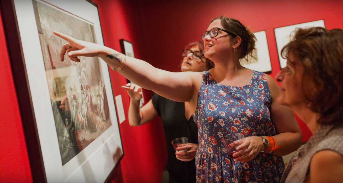 Bailey Harper '19 pointing at a photo in The Plains of Mars exhibition