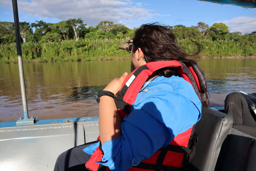 student on a boat in a river in the Amazon rainforest