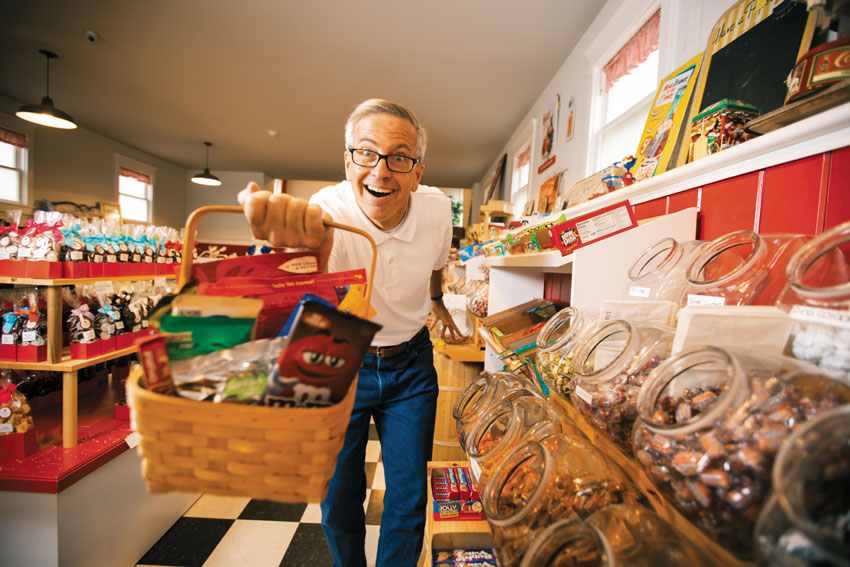 David Borghesani with a basket of candy in a candy store