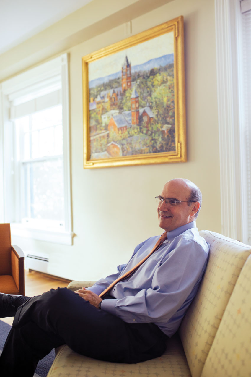 Bob Iuliano sitting with a painting of historic Gettysburg College