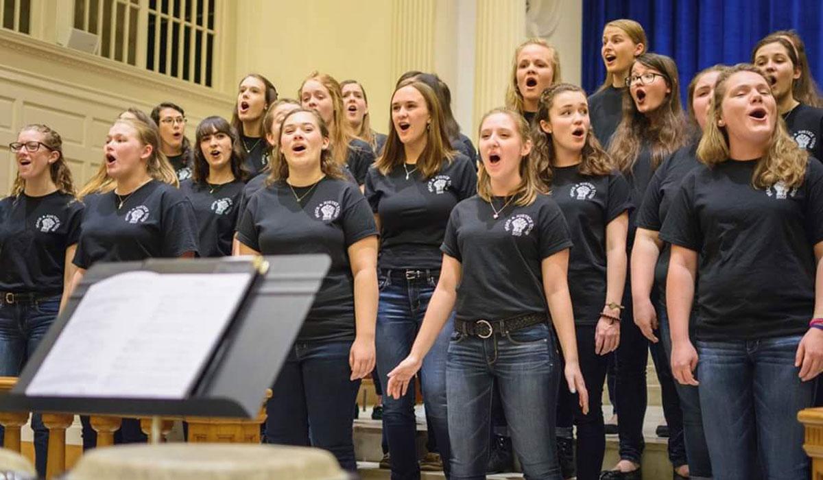 Female choir singing in a church