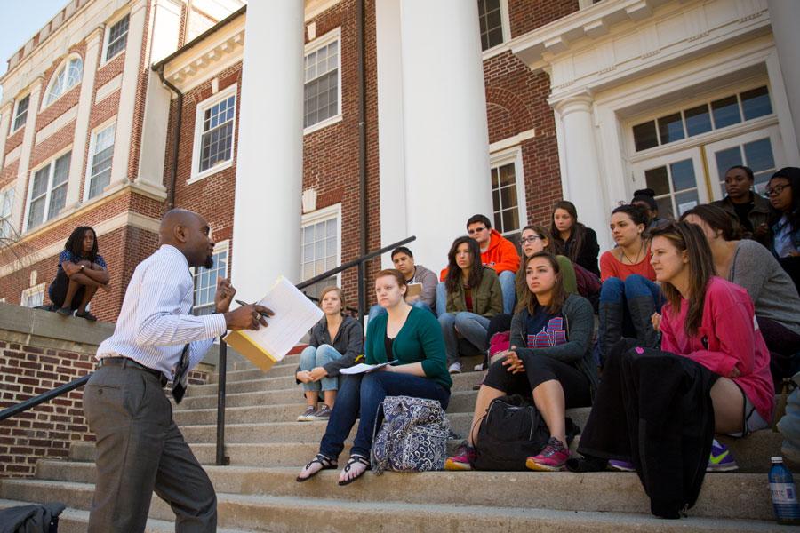 Prof. Hakim Mohandas Amani Williams teaching students outside of Weidensall Hall