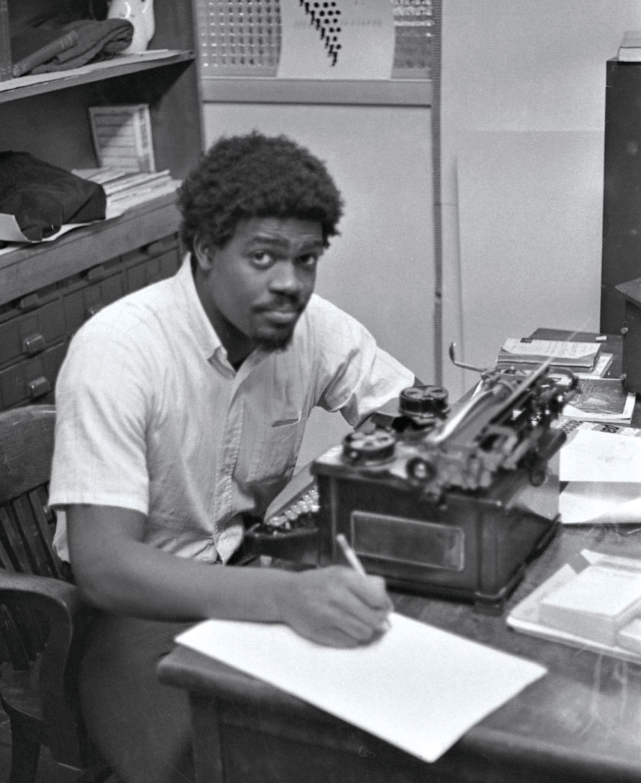 Leon Glover '71 writing at his desk