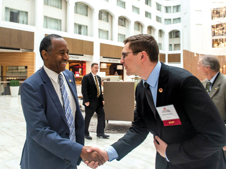 Photo of Josh Stewart and Ben Carson '11 shaking hands