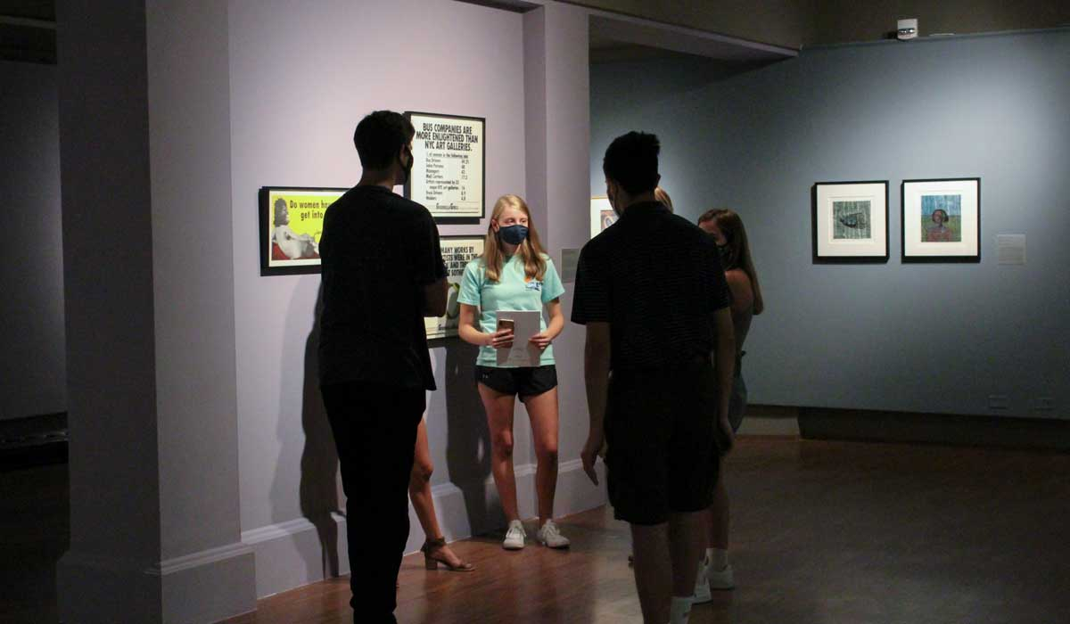 People viewing Mexico and the People exhibition at the Schmucker Art Gallery