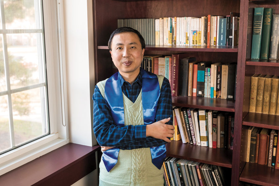 East Asian Studies Professor Junjie Luo with his stole of gratitude