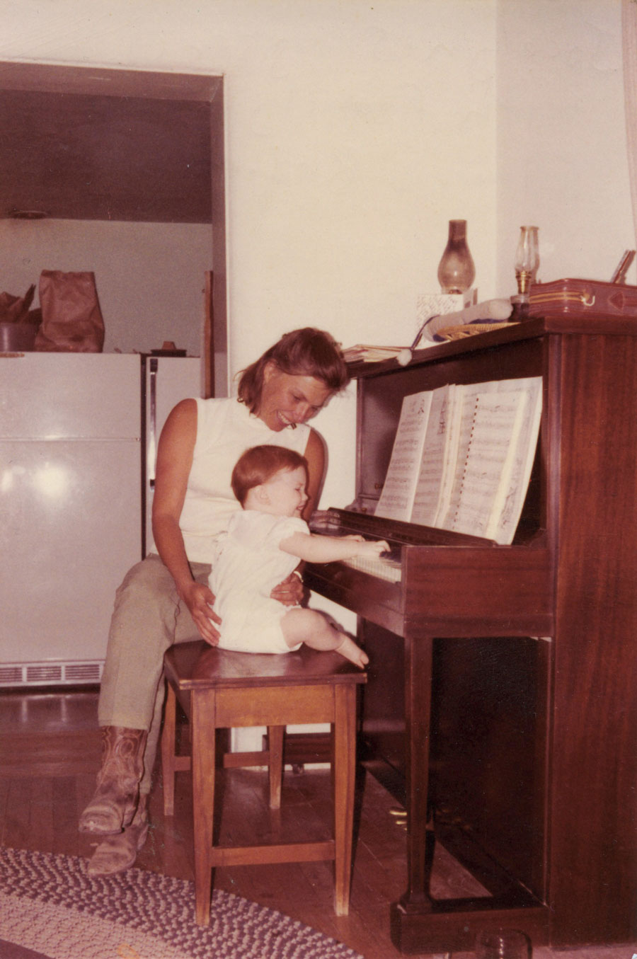 Jocelyn Swigger playing piano as a baby