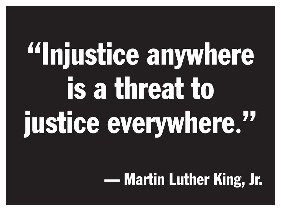 Sign with Martin Luther King quote - Injustice anywhere is a threat to justice everywhere