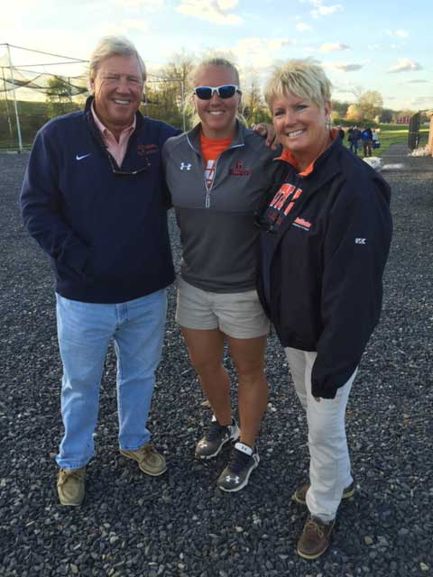 Hal and Teena Mowery posing with their daughter women's field hockey assistant coach Ashley Mowery