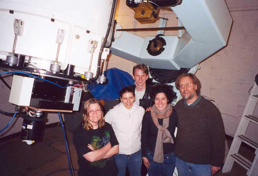 Larry Marschall posing with colleagues at the Lowell Observatory in Arizona