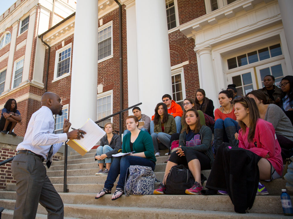 Prof. Williams teaches class on the steps of Weidensall Hall