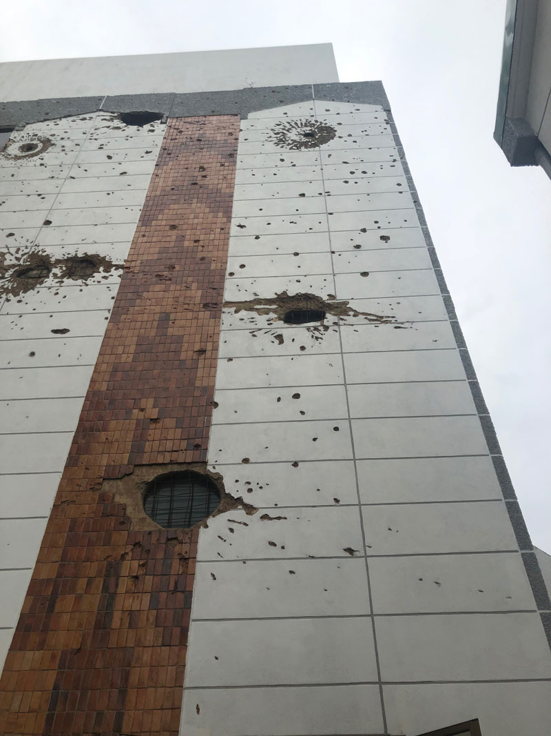 Holes in the side of the Parliament building in Kigali, Rwanda