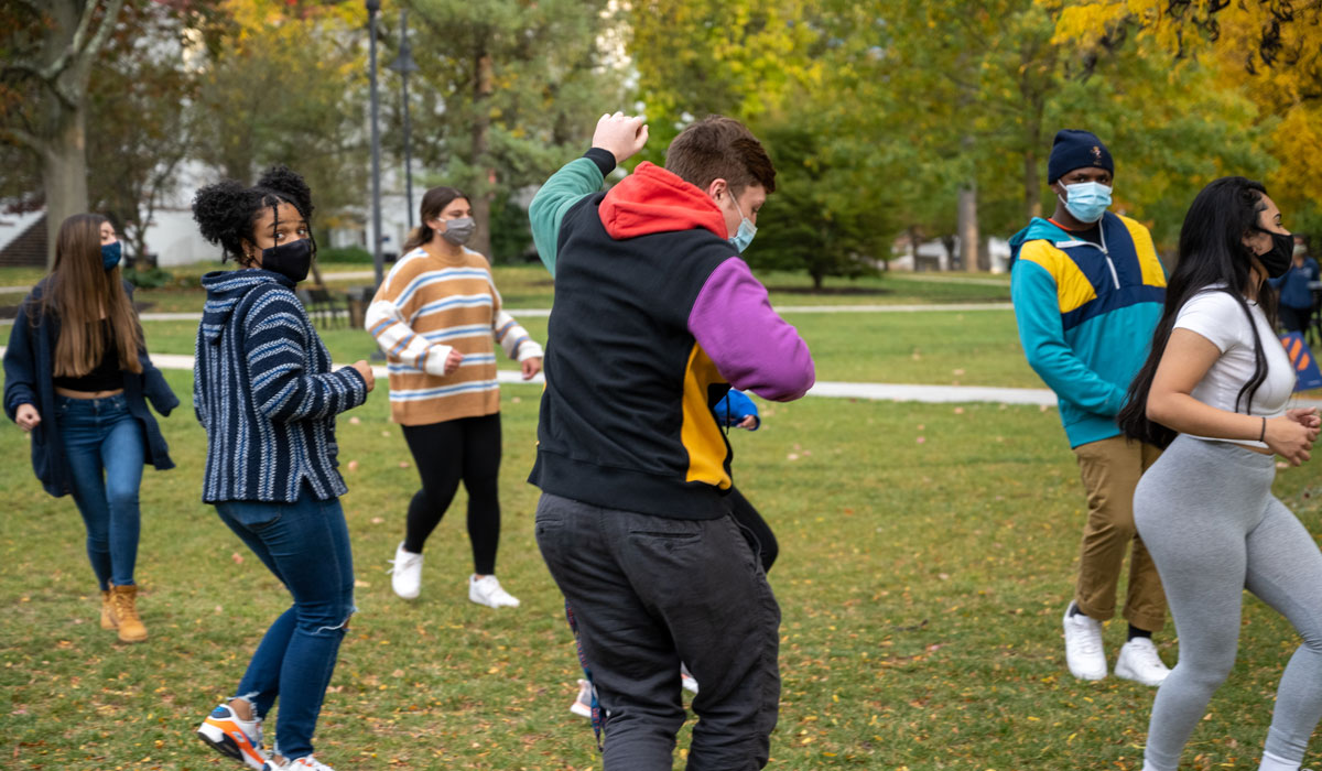 Students taking salsa lessons on Gettysburg College's campus during Salsa on the Square
