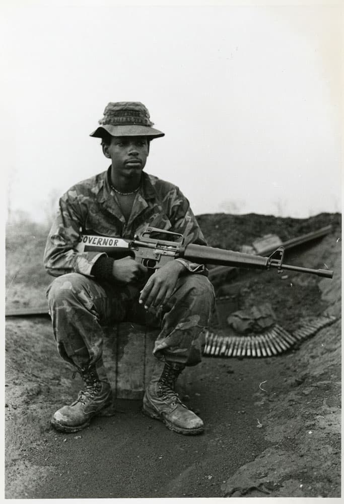 Soldier sitting with a rifle