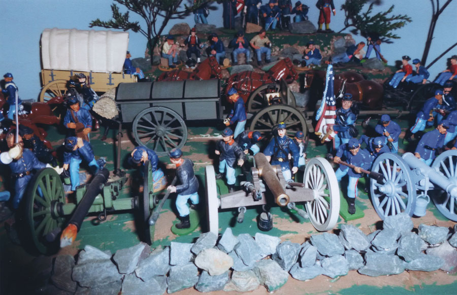 Toy civil war soldiers staged in a battle scene