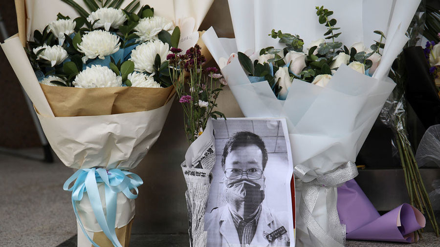 Flowers and a photograph of doctor Li Wenliang