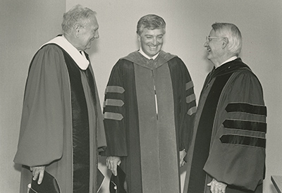 Haaland shown on his inaugeration day, flanked by interim president Charles Anderson (l) and former president Charles E. Glassick (r)