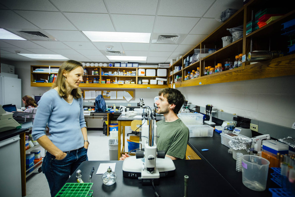 Prof. Powell in the lab with a student