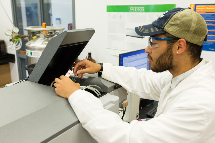 Alex working with the Circular Dichroism Spectropolarimeter