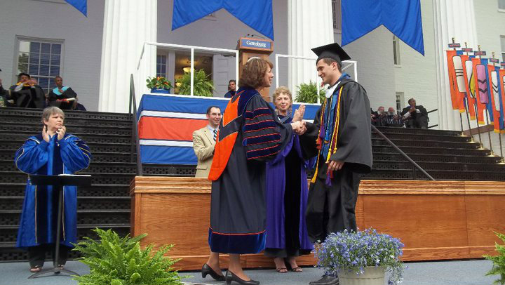 Svet Semov crossing the stage and shaking hands with President Janet Morgan Riggs '77 at Commencement.